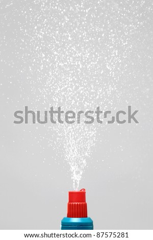water spray under pressure against gray background