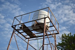 Water storage container on top of a small tower