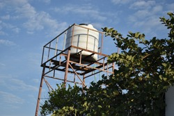 Water storage container tank on top of tower