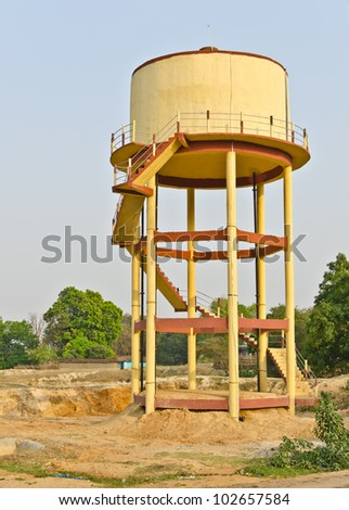 Water storage tank in a rural area for the supply of drinking water - stock photo