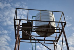 Water storage tank on top of small tower