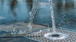 Water stream splashing on ground. park floor fountain