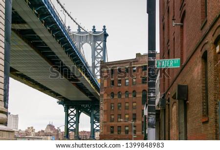 Water street and Manhattan bridge in Manhattan New York, US #1399848983
