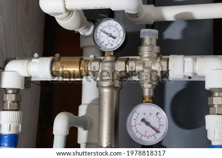 Water supply pipes with pressure gauges, valves and check valve Stock photo ©