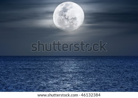 Water surface under moonlight at nighttime. Pacific Ocean