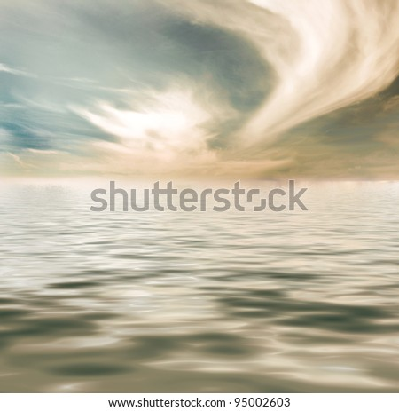 Water surging at high tide, near sunset with a wide sweeping cloud.