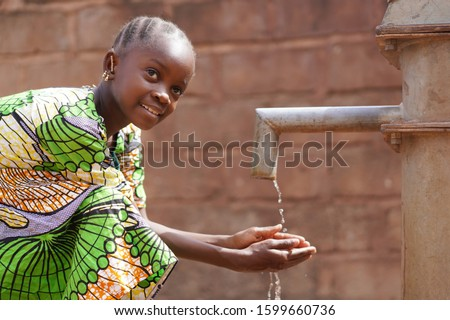 Water symbol of African Black Girl Kid Child Washing and Drinking Stock photo ©
