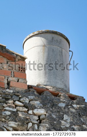 Water tank for the consumption of a house formerly used to supply a family.