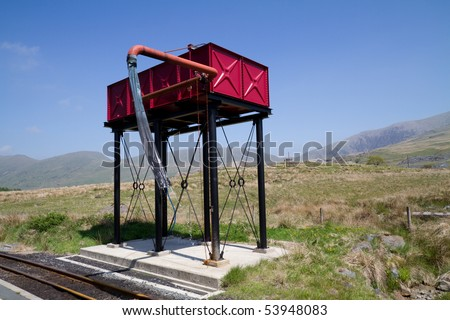 Water tank tower for refilling steam trains on the narrow guage railway in the Snowdonia national park, Wales, UK