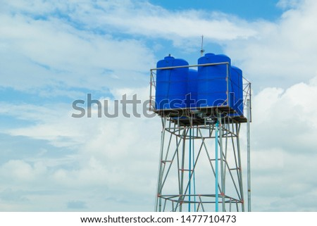 Water tank ,Water tank tower and blue sky stock photo