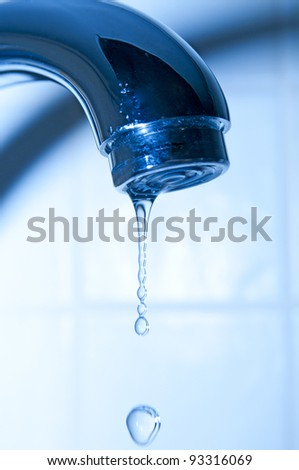 Water tap and droplets