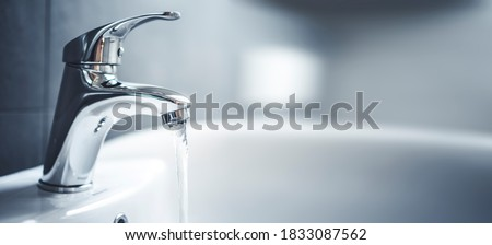 Water tap , faucet. Flow water in bathroom with sink. Modern clean hause. Backround hygiene. Panorama Photo stock ©
