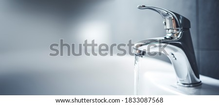 Water tap , faucet. Flow water in bathroom with sink. Modern clean hause. Hygiene concept.  Panorama