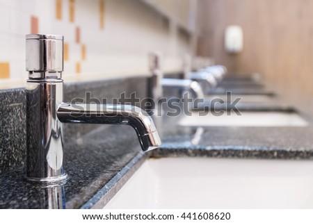 Water tap inside restroom #441608620