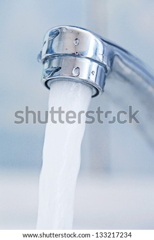 Water tap. Macro image with selective focus.
