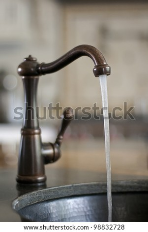 Water tap with running water, wasting water