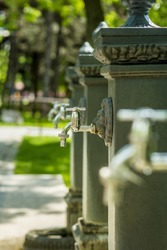 Water taps outside in a park