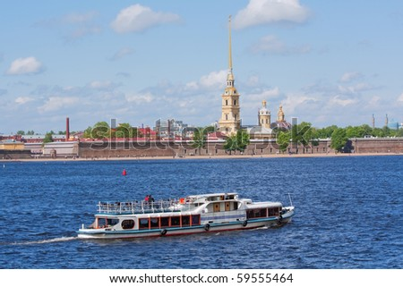 Water taxi motors by the Peter and Paul Fortress on the Neva River in Saint Petersburg, Russia