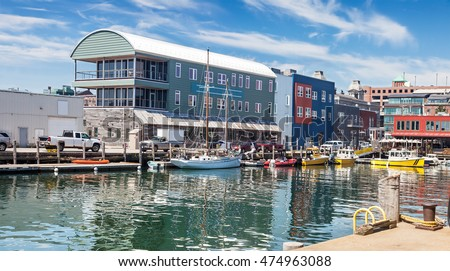 Water taxis and boats on the busy Maine Wharf, Portland, Maine #474963088