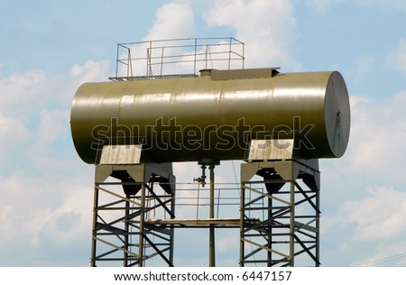 Water tower on blue sky background