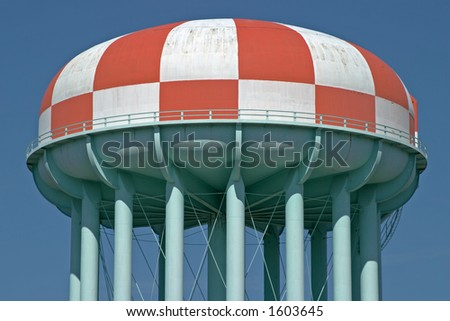 Water tower painted in a red and white checkerboard pattern