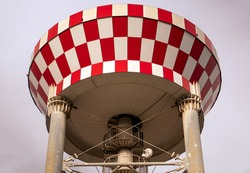 Water tower with red and white stripes. Water reserves