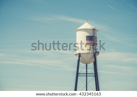 Water tower with Stars & Stripes flag, USA