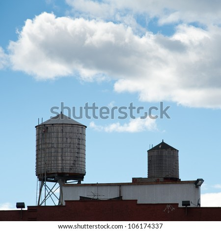Water towers on a roof of a building in New York City.