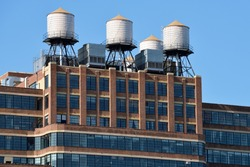 Water towers on the roof of a building in New York City