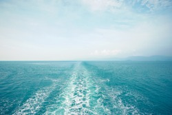 Water trail foaming behind a ferry boat in Aegean sea, Greece, Europe, Boat wake in the sea, on a brilliant sunny day. This is the view behind a car ferry..