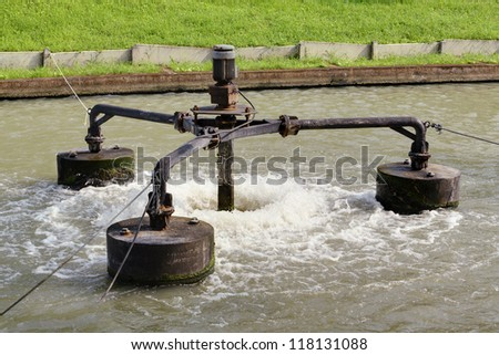 Water treatment by aerator - stock photo