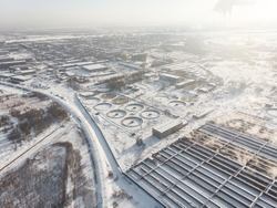 Water treatment facilities. Sewer system. Industrial winter landscape