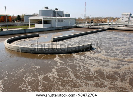 Water treatment plant on sunny day recycling polluted water