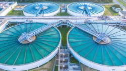 Water treatment solution, Industrial water treatment‎, Aerial top view recirculation solid contact clarifier sedimentation tank, Ecosystem and healthy environment concepts and background.