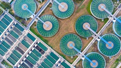 Water treatment solution, Industrial water treatment, Aerial top view recirculation solid contact clarifier sedimentation tank, Ecosystem and healthy environment concepts and background.