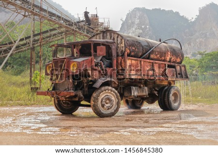 Water truck wetting the land to reduce airborne dust in a construction site