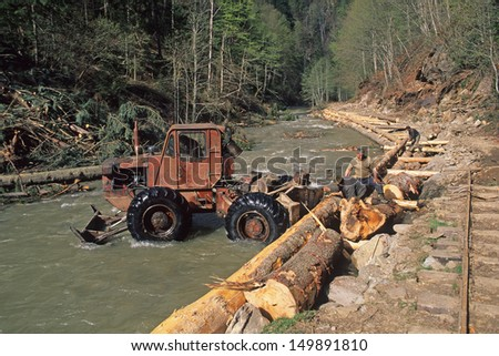 WATER VALLEY, MARAMURES, ROMANIA - APRIL 26: forest tractor fix damaged railway on April 26, 2000 in Water Valley, Maramures, Romania. Those tractors work best in the mountain forests of Carpathians.