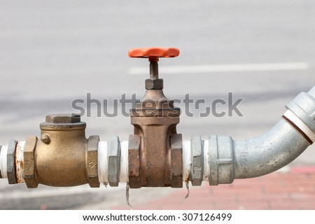 Water valve of brass mounted connect with steel pipe.