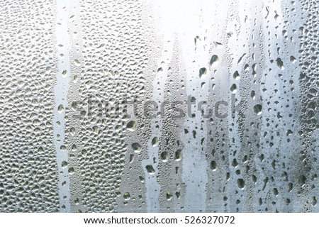 Water vapor in cold glass of window. Winter background Сток-фото ©