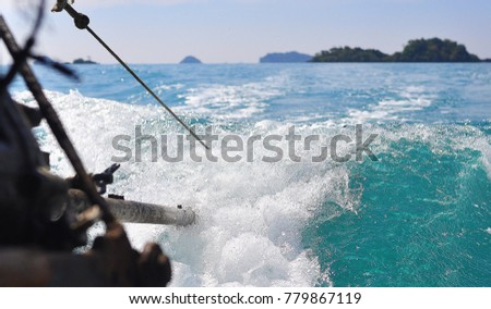 Water wave from the propeller of the boat. #779867119