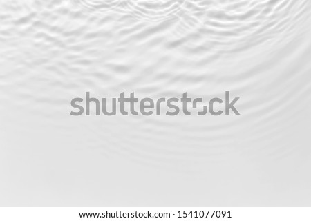 Water waves on the pool. Abstract background. Black and white concept. stock photo