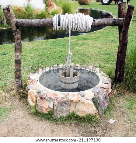 free photos old water well with pulley and bucket in garden avopix com