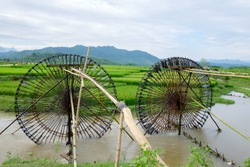 Water wheel is an essential agricultural tool that helps locals deliver water from the lower rivers or streams to the higher rice paddies for irrigation