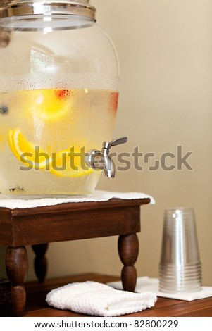 water with fruits and berries in the water dispenser in spa