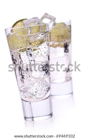 water with ice and lime on white background
