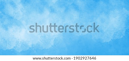 Watercolor background in blue and white painting with cloudy distressed texture grunge, soft fog or hazy lighting and pastel colors