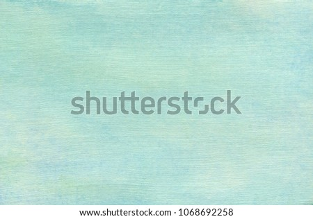 Watercolor background on a paper with canvas texture. Overcast sky pale blue-green color.