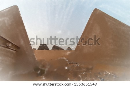 watercolor illustration: Restored pyramids of Meroe, taken with the wide-angle lens, Sudan