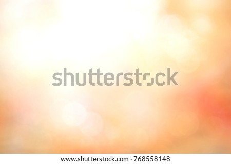 Watercolor of sun light and abstract blurry orange autumn sunset background