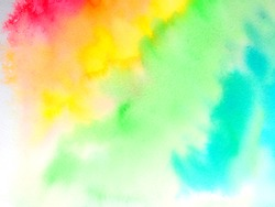 watercolor paint of different colors spread on white paper